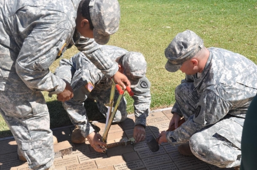 PFC ROSARIO-SGT RIVERA-SSG HUGHES HELP TOM LAY BRICKS